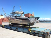 Everyman Boats New Release 850 Pro Fisher at wharf